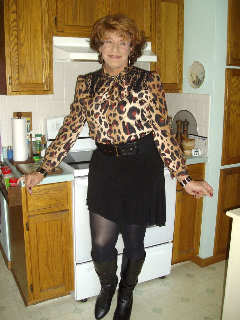 Mature women in tops in skirts in the kitchen